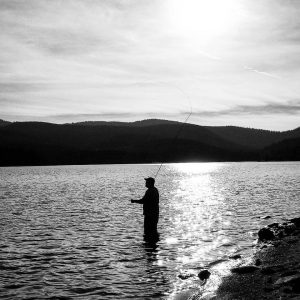 This is a photo of George Gess fishing at Hog Park Reservoir in Wyoming.