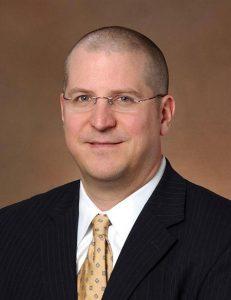 profile photo of Dr. Brett Reece, who preformed the David Procedure.