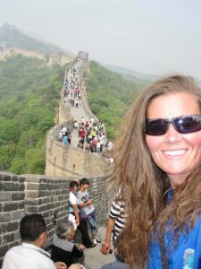 Marybeth Hoffman posing at the Great Wall in China.