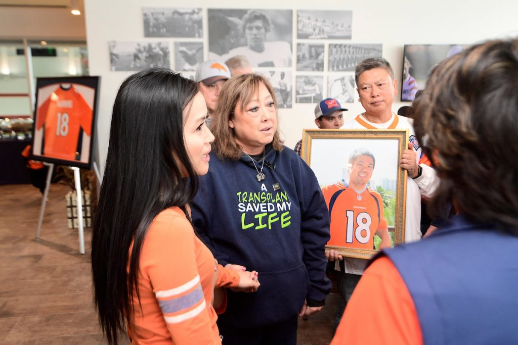 "Linda Regis wears a sweatshirt saying, ""A transplant saved my life"" while she, a transplant recipient, meets family of the donor."