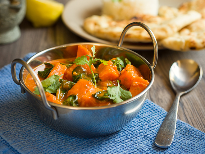 Curried sweet potatoes can be a delicious addition to your Thanksgiving table.