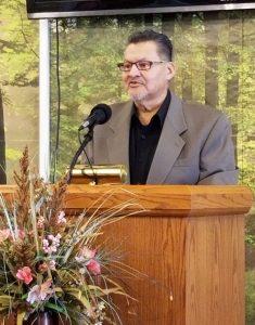 Michael speaking at the church podium.