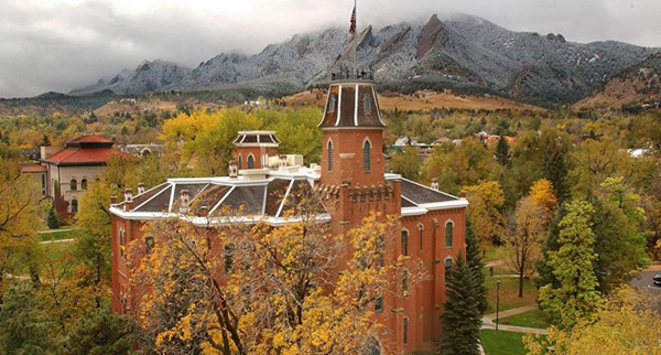 Old Main at the University of Colorado in Boulder with the snow-dusted Flatirons in the background