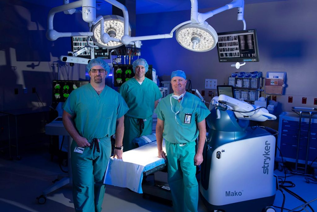 A photo of three orthopedic surgeons in a surgery suite at UCHealth Grandview Hospital.