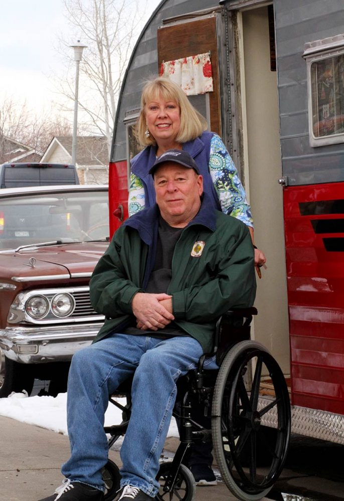 Rich in a wheelchair and Sue in front of their classic 1950s camper and car. they enjoy those things in retirement but had to focus on health a bit more after being in the prediabetes range.