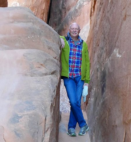 Paul Hutton after surgery for a bad spine infection, standing among the rocks at Arches National Park.
