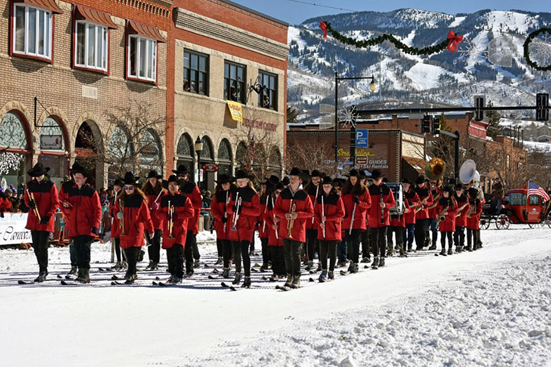 This is a photo of the Steamboat Springs High School marching band on skis.