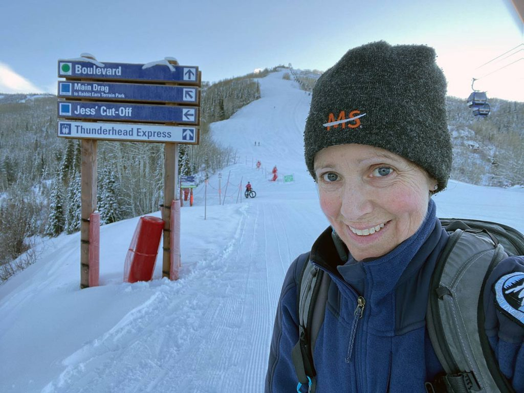 this woman navigates MS by hiking up the ski mountains, a picture of her during one of those hikes.