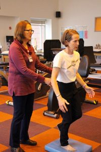 Woman navigates MS with help from physical therapist in rehab gym