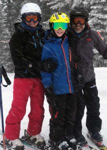 The Malone family enjoys a ski day in this photo.