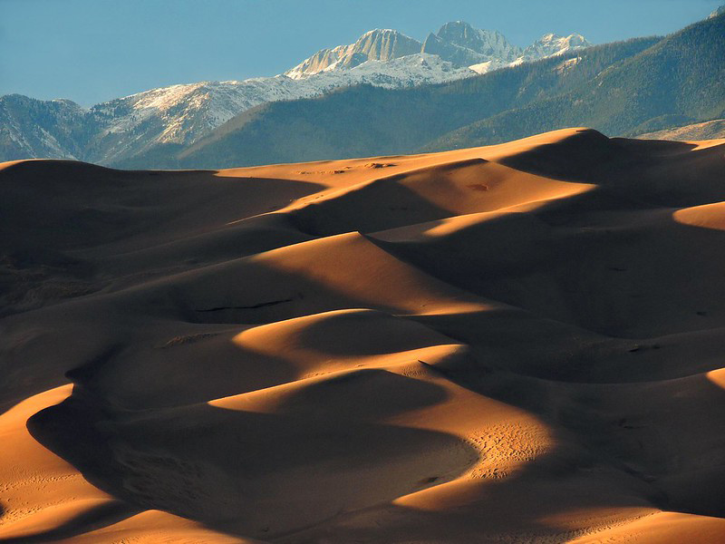 Great Sand Dunes National Park is great during all seasons. Here the dunes are in the foreground with snowy peaks in the background.