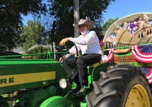 Jack Silva, a heart disease patient, on his tractor at a local parade.