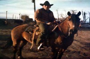 old photograph of Jack Silva on a horse on their colorado farm.