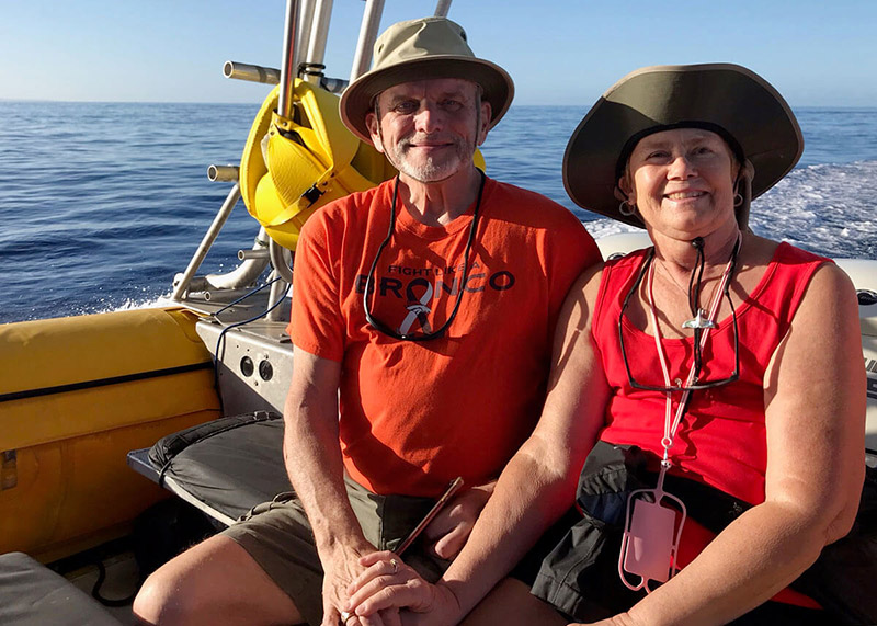 husband and wife on a boat in Hawaii after surgery for knee arthritis.