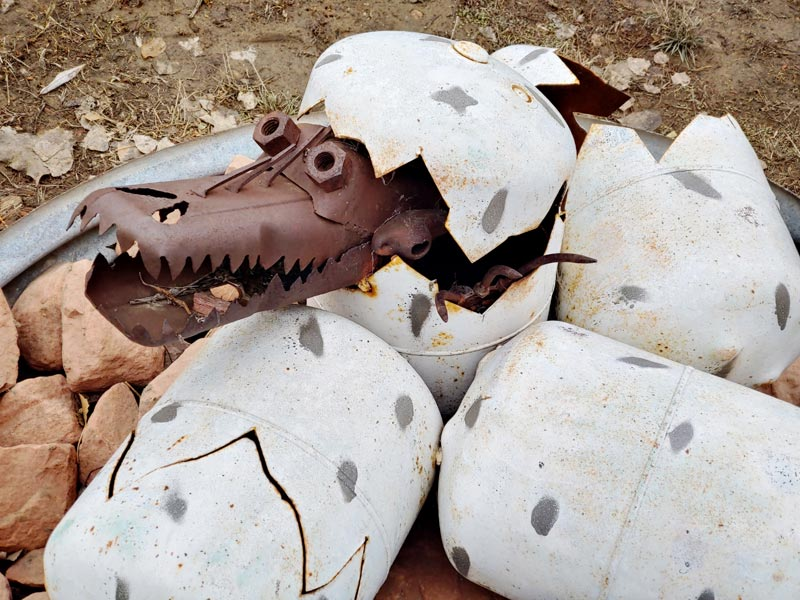 propane tanks painted as eggs with a metal creature coming out of one.