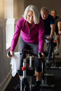 older adults on spin bikes at a gym, which should be avoided during the coronavirus outbreat.