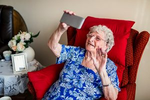 Older woman does a video call for story about helping older adults use video calling