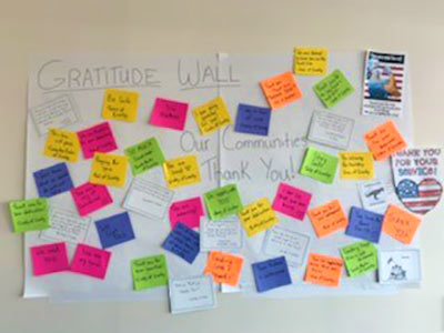 letters from Colorado residents thanking health care workers are posted at the employee entrance of Greeley hospital.