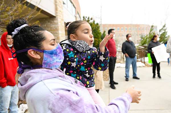 JBS worker, Sergio Rodriguez, was greeted by one of his great granddaughters as he left UCHealth Medical Center of the Rockies on Saturday.