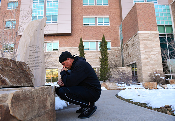 Son prays outside the hospital room of his dad, Sergio Rodriguez, a longtime JBS worker who got sick with COVID-19.