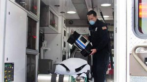 EMT responding to a medical emergency during the pandemic.