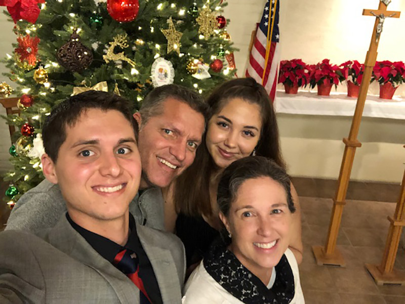 Amy Kirch, bottom right, home in Tucson, Arizona with her family after surviving a catastrophic car accident and stroke. Left to right: Son Zachary, husband Jay and daughter Jordan. Photo courtesy of Amy Kirch.