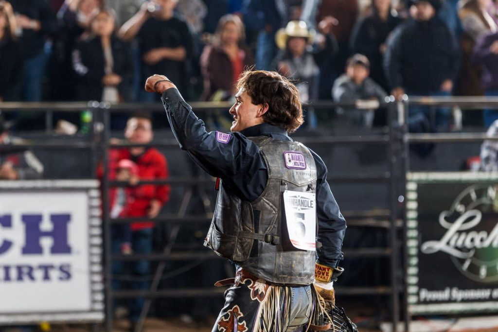Fritzlan acknowledges the crowd in El Paso after limb-restoration surgeries saved his rodeo career.