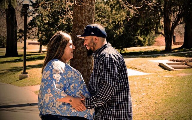 Pregnant Jade and Mike in a park. Jade would give birth while covid-positive at 35 weeks pregnant.