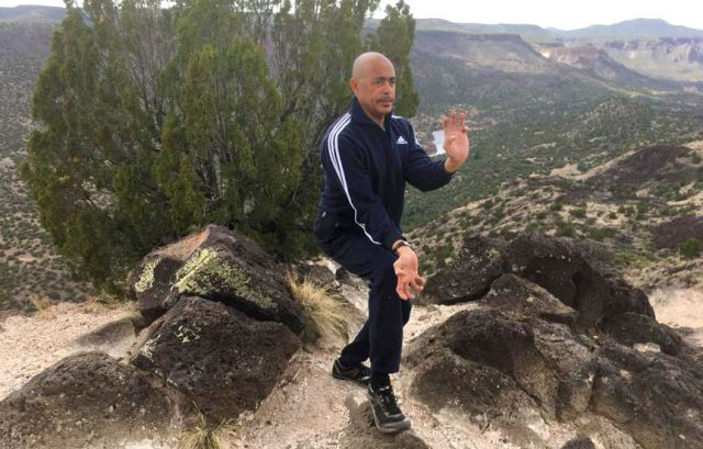 Man doing karate in the hills, enjoying life with a life with left ventricular assist device.