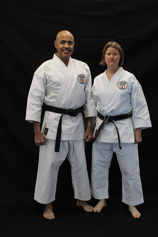 man and his wife pose in karate gear, getting back to life with a left ventricular assist device.