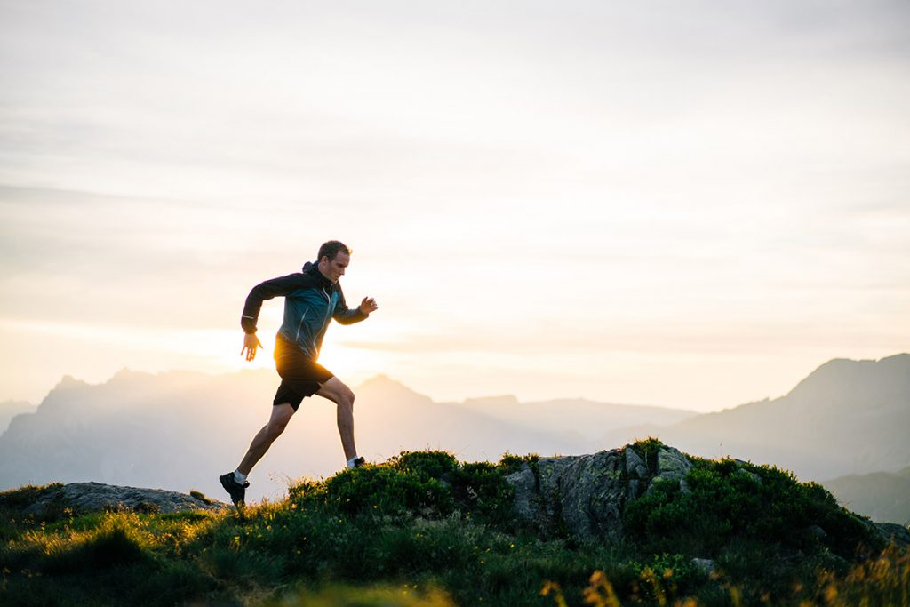 Paying attention to tips before you start running will keep you safe, like this man atop a mountain.