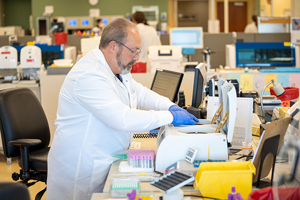 High-quality antibody tests are now available to the public in Colorado at various locations throughout Colorado. Here, a lab manager works on tests at a UCHealth lab.