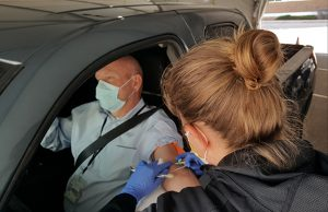 man get's blood drawn at drive-thru testing site, which is now also open at highlands ranch hospital.