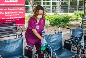 Are hospitals safe? this women shows they are by wiping down outside wheelchairs.