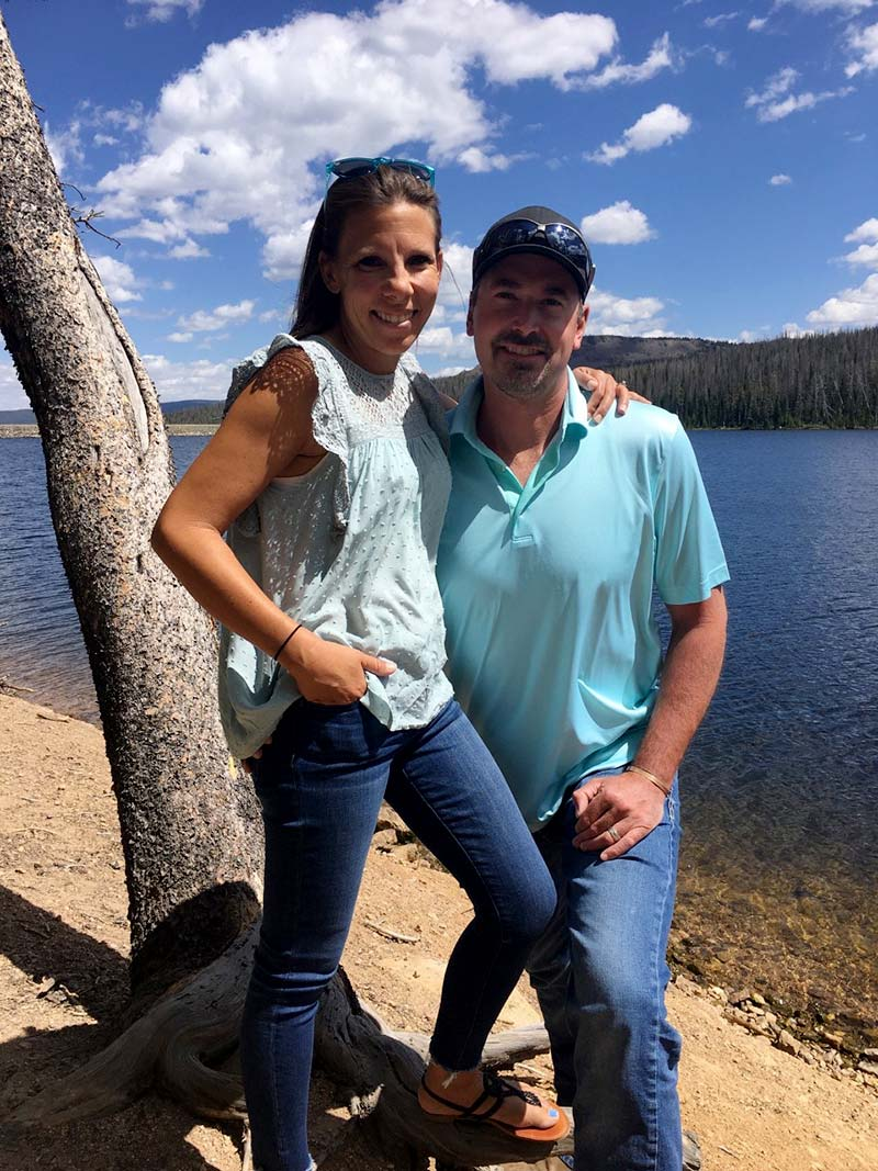 Carly and husband by a lake after she got heart failure caused by pregnancy.