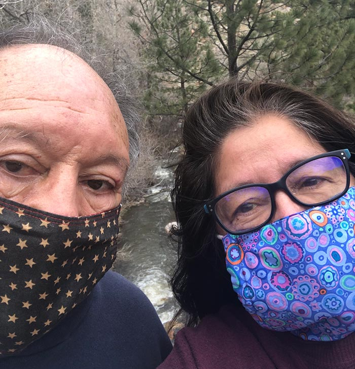 selfie of sam and paula wearing masks on a hike