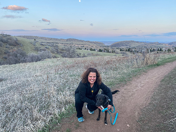 Dr. Michelle Barron, the top infectious disease expert in Colorado, hanging out with her dog, Chase.