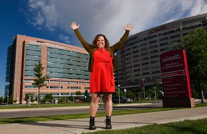 Dr. Michelle Barron, the top infectious disease expert in Colorado. Here, she holds her arms up in front of UCHealth University of Colorado Hospital.