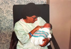 mom holds newborn, who is among the family's four generations born at the same hospital.