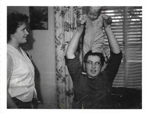 baby on his uncles shoulders, both among the family's four generations born at the same hospital.
