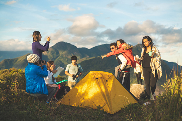 Camping in Colorado during the COVID-19 pandemic can be a great way to enjoy nature while staying safe. A family camping on a ridge over lookign the mountains. Photo: Getty Images.