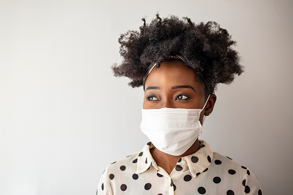 the science of masks. A young woman wears a mask.