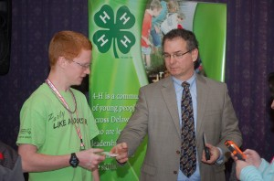 Dylan Bradley & Dr. Gillio exchange information. Gillio is eager to have 4-H'ers become a Force for Health