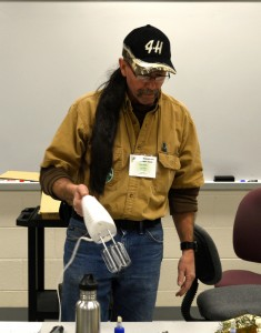 Clyde Mellin wears a fake ponytail to show how easily hair can get trapped in tools