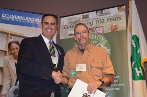Ernie Lopez, UD Extension specialist presents Clyde Mellin with the Salute to Excellence Award. As of March, Mellin is a county, state and Northeast regional winner