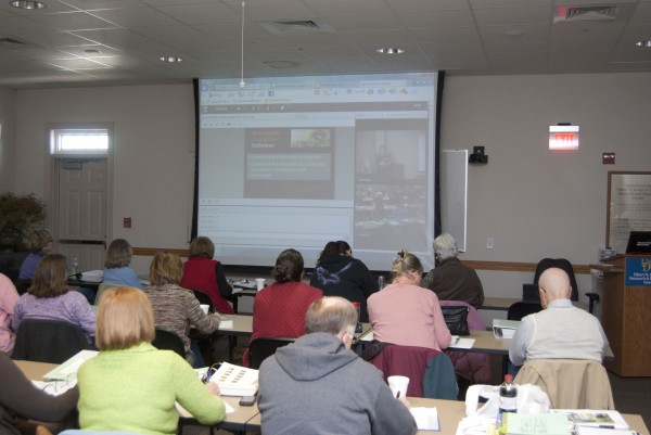 Master Gardeners listen to a Sustainable Landscape lecture via technology.  Barton usually teaches in person, but the distance technology is occasionally used when convenient or a conflict in a schedule. A live Q & A session is incorporated with distance learning