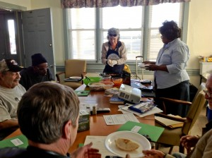 Master Food Educator Nancy Kassner and EFNEP Nutrition Assistant Mary Jennings teach food skills at a workshop at the Home of the Brave in Milford