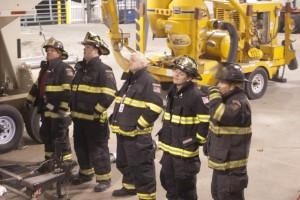 Members of the Magnolia Fire Department observe