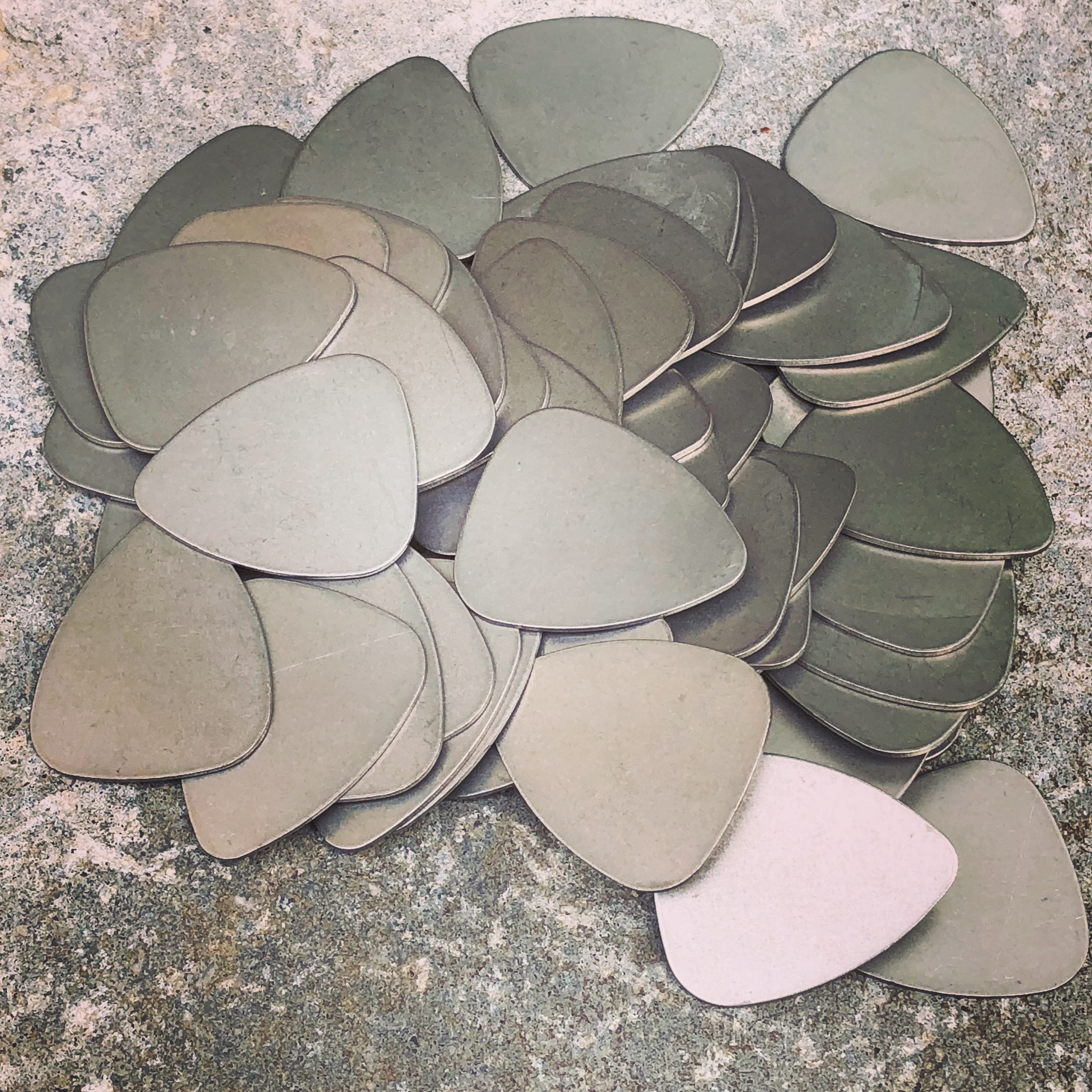 Raw titanium guitar picks.  Lots of work to finish.