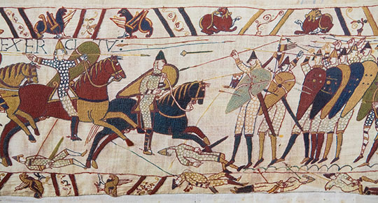 BAYEUX, FRANCE - FEB 12: Detail of the Bayeux Tapestry depicting the Norman invasion of England in the 11th Century on February 12, 2013